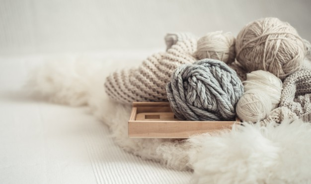 cozy-background-wallpaper-with-yarn-knitting_169016-6305